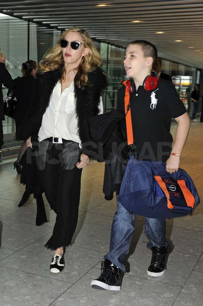 Madonna with Rocco Ritchie at Heathrow Airport.
