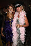 Princess Beatrice with someone dressed up to honor Freddie Mercury.