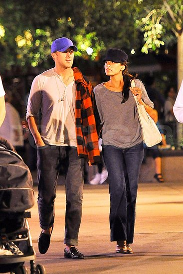 Ryan Gosling and Eva Mendes holding hands at Disneyland.