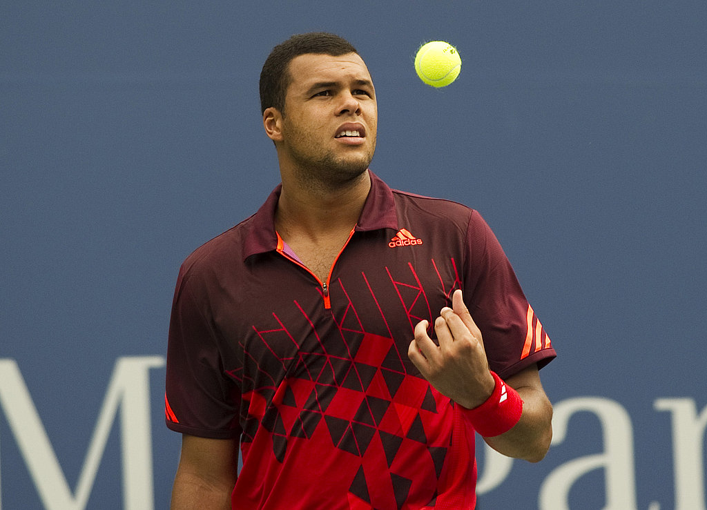 Jo-Wilfried Tsonga of France tosses a ball in the air on Monday.