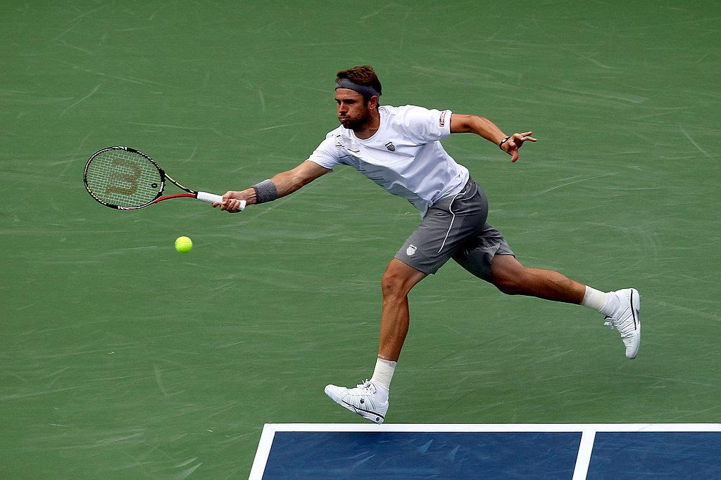 Mardy Fish shows off his leg muscles.