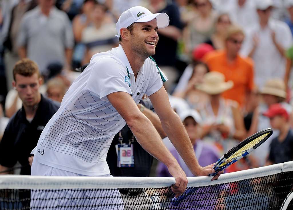 Andy Roddick flashes a smile as he celebrates his win over Julien Benneteau.