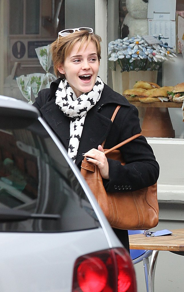 Emma Watson smiles in London.