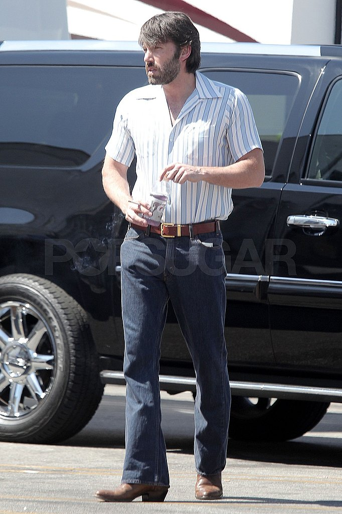 Ben Affleck changed into retro jeans and short sleeve shirt.