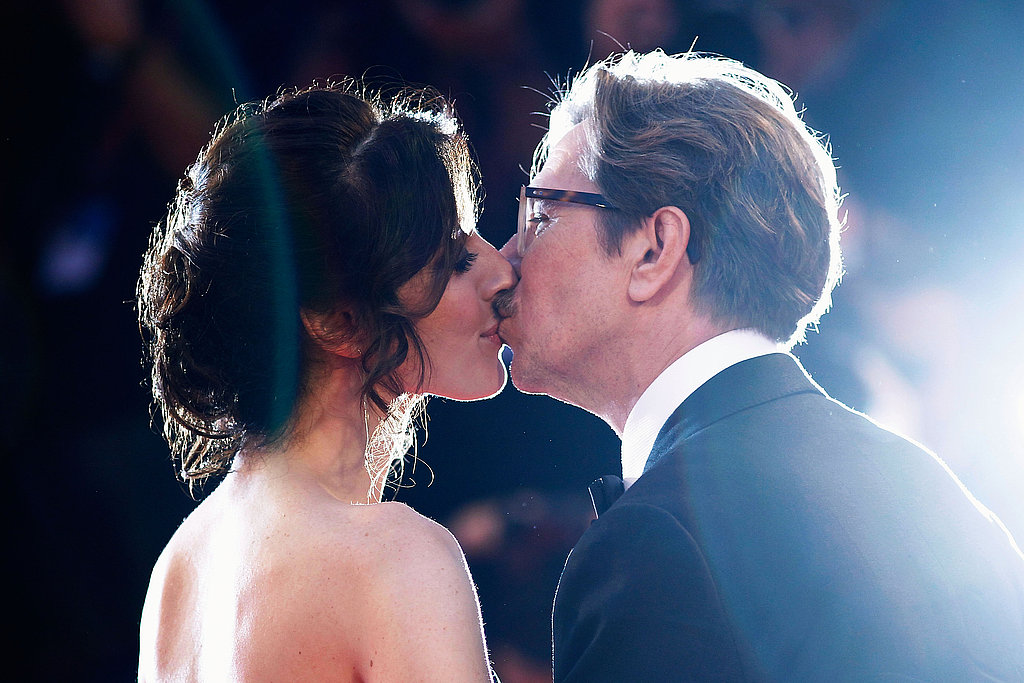 Gary Oldman steals a kiss from his wife, Alexandra Edenborough, on the red carpet for the screening of Tinker, Tailor, Soldier, Spy.