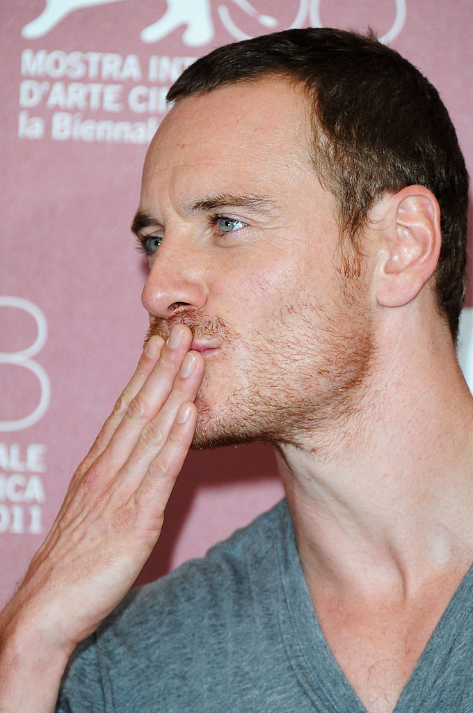 Michael Fassbender blows a kiss at the Shame photo call.