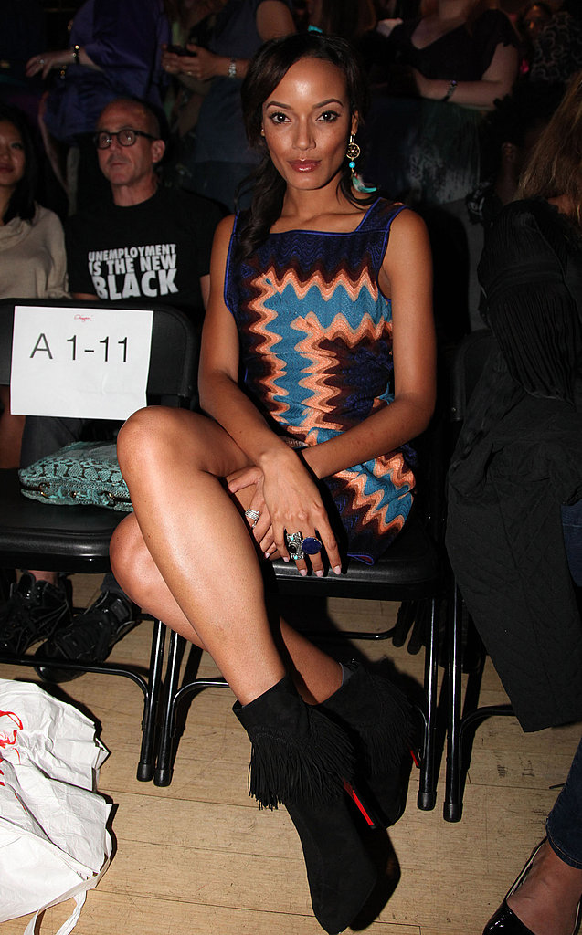 Selita Ebanks attended the Origami Clothing line launch in a purple print mini and black suede ankle boots.
