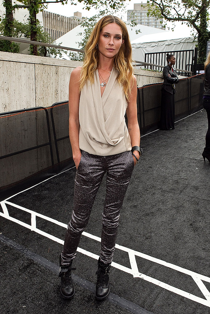 Erin Wasson looked cool and collected in draped top and skinny satin trousers.