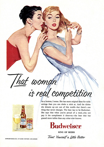 "This 1956 ad hopes to convince housewives that Budweiser will help them win the competition for best hostess ever. The copy reads, ""The beer has to be Budweiser. She says that when you're proud of a meal, why not pay it the compliment it deserves — the beer that has graced more tables than any other ever known."""