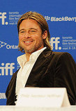 Brad Pitt showed off his sexy smile in Toronto.