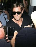Ryan Gosling surrounded by fans.