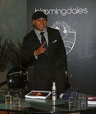 LL Cool J wore a checkered shirt to Bloomingdale's during New York Fashion Week.