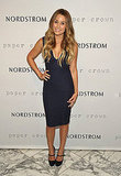 Lauren Conrad in a navy blue dress.