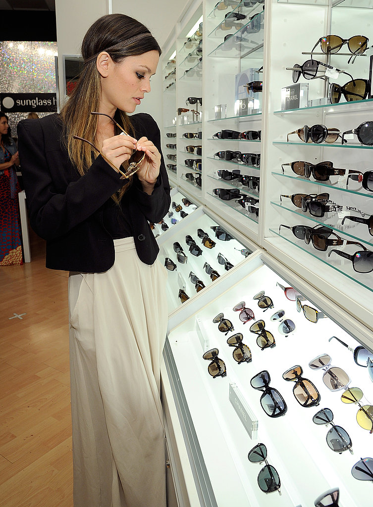 Rachel Bilson tried on sunglasses at Sunglass Hut.