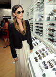 Rachel Bilson tried on sunglasses on Fashion's Night Out.