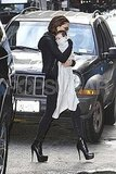 Victoria Beckham Cuddles Harper Close and Struts on Dangerously High Heels in NYC