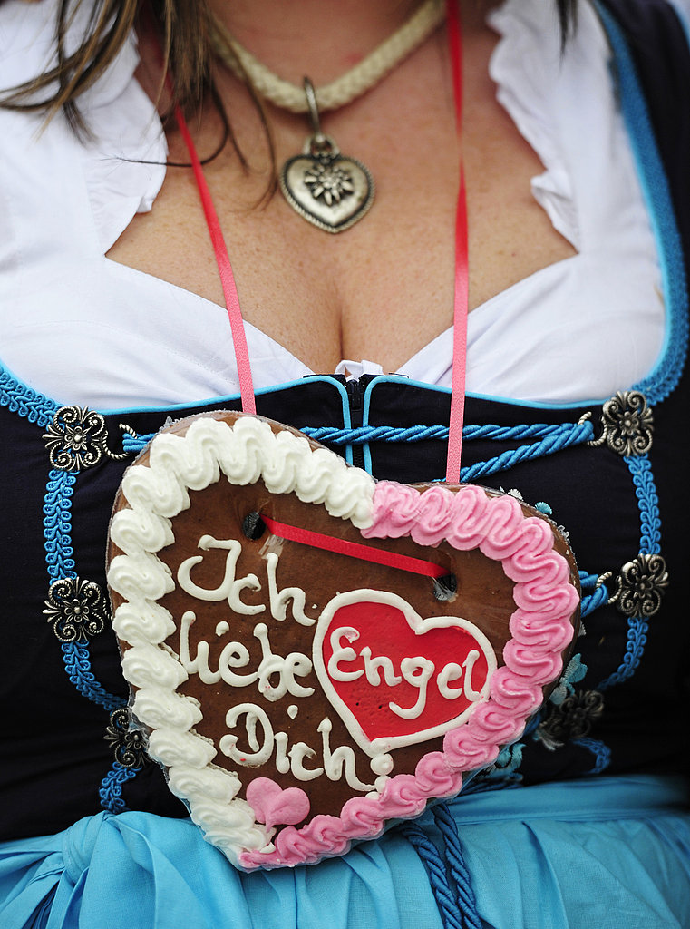 "A woman wears a gingerbread heart that reads, ""I love you, Angel."""