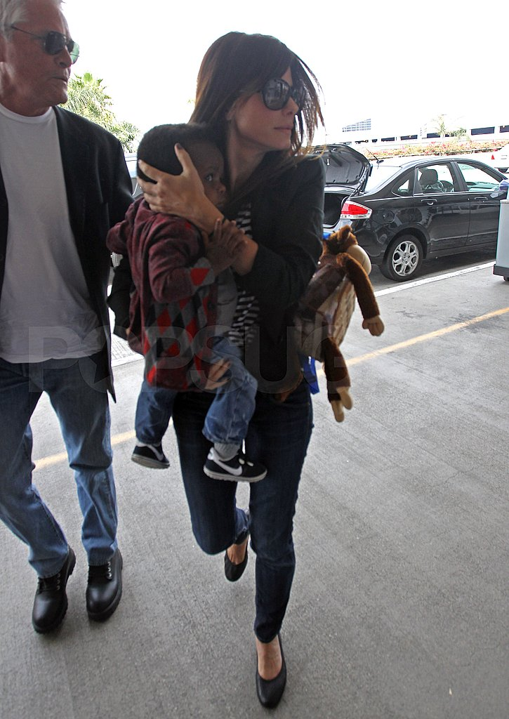 Sandra Bullock and Louis Bullock headed to a flight.