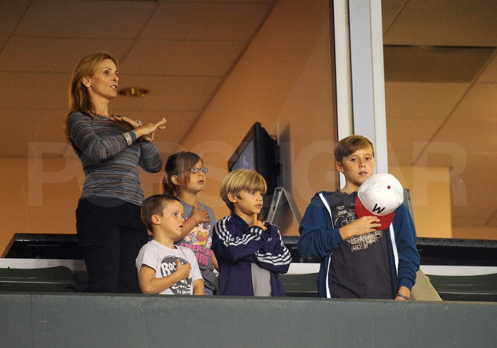 Cruz, Brooklyn and Romeo Beckham watched David's soccer game.