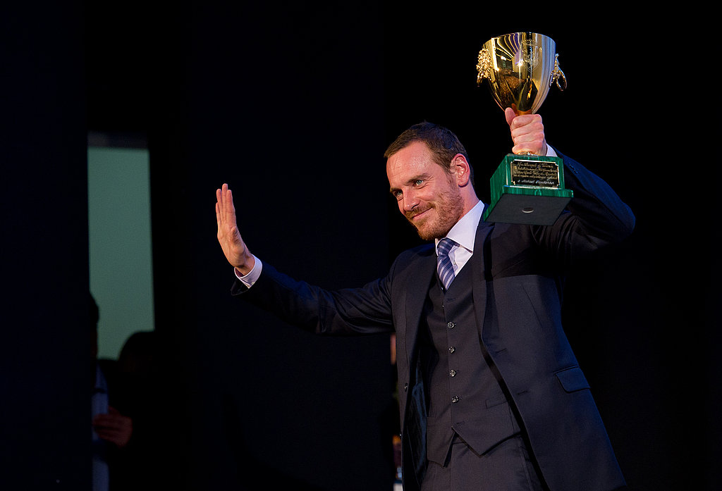 Michael Fassbender accepts his honor at the Venice Film Festival closing ceremony.