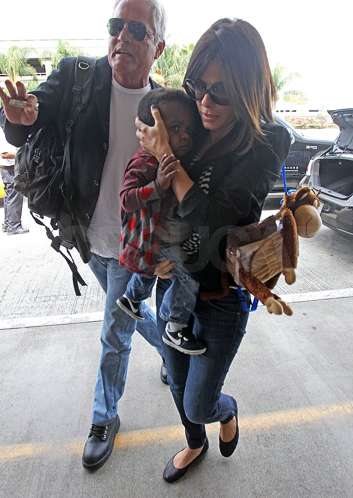 Sandra Bullock made her way to LAX with baby Louis.