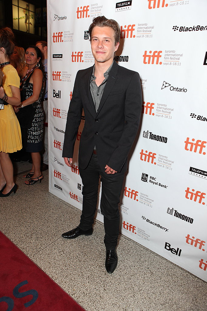Xavier Samuel posed for pictures at the theater.