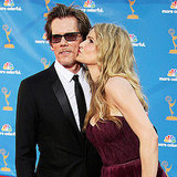 Kyra Sedgwick gave husband, Kevin Bacon, a smooch on the 2010 carpet.