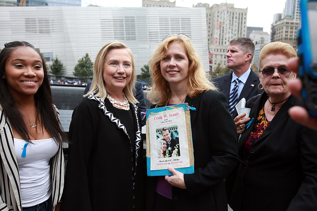 US Secretary of State Hillary Clinton poses with a woman who lost her brother during the 9/11 attacks.