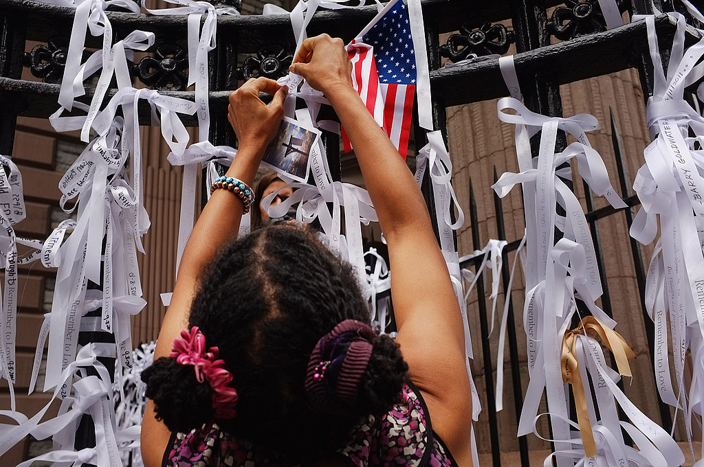 A woman places a ribbon of remembrance on the fence outside of St. Paul's Chapel on 9/11.