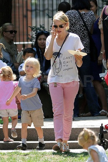 Naomi Watts wears pink pants at the park.