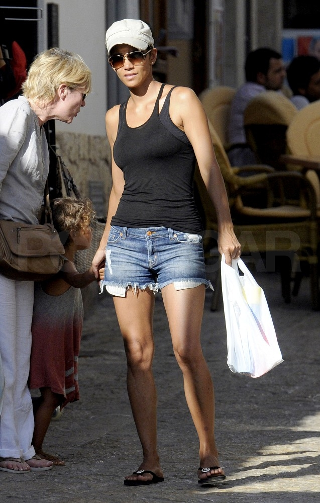 Halle Berry in a hat and sunglasses.