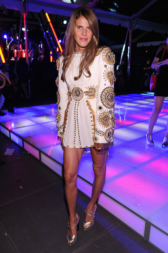Anna Dello Russo makes an appearance in a super short mini and metallic heels.