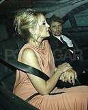 Kate Hudson and Matt Bellamy hold hands.