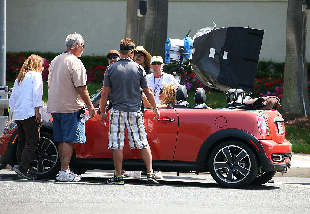 The production crew set up the shot before Blake took off in the car.