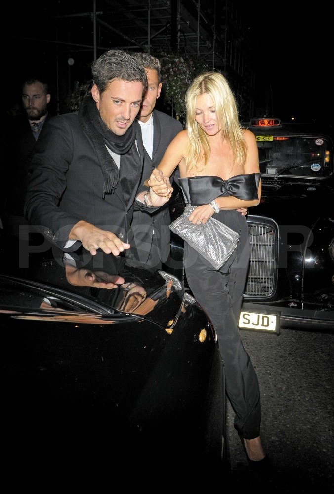 Kate Moss in an Azzaro jumpsuit and Stella McCartney bag.