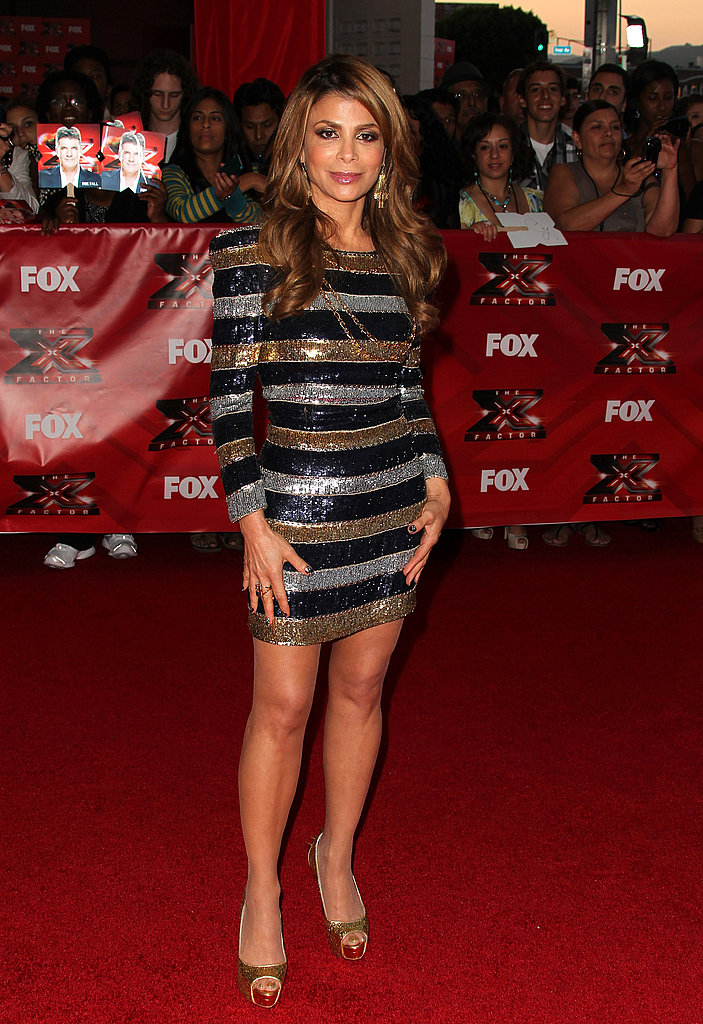 Paula Abdul highlights her dancing legs in a sexy minidress.