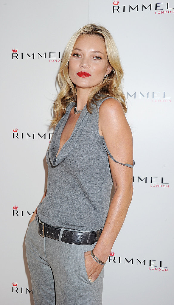 Kate Moss celebrates her new lipsticks.