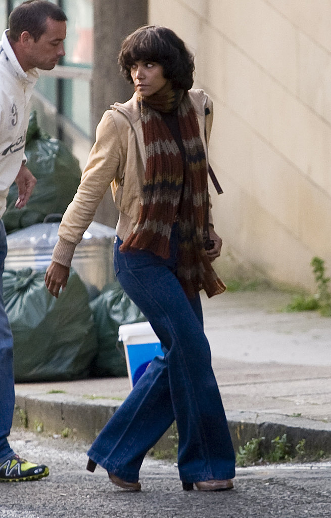 Halle Berry dressed in 1970s garb.