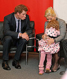 Prince Harry makes a pouty face at a little girl during a reception for the German charity Ein herz fur Kinder (A Heart For Children), where he received an award for his charitable work in 2010.
