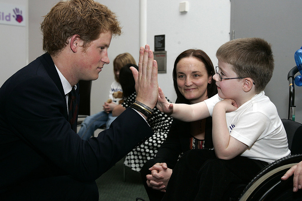 Harry high-fives a young boy during the WellChild Children's Health Awards ceremony in 2007.