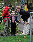 Prince Harry talks with Bear Grylls and a young boy during the launch of The Soldier Challenge 2011 at The Imperial War Museum in London last year.