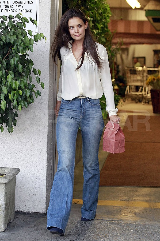 Actress Katie Holmes in wide-leg jeans.