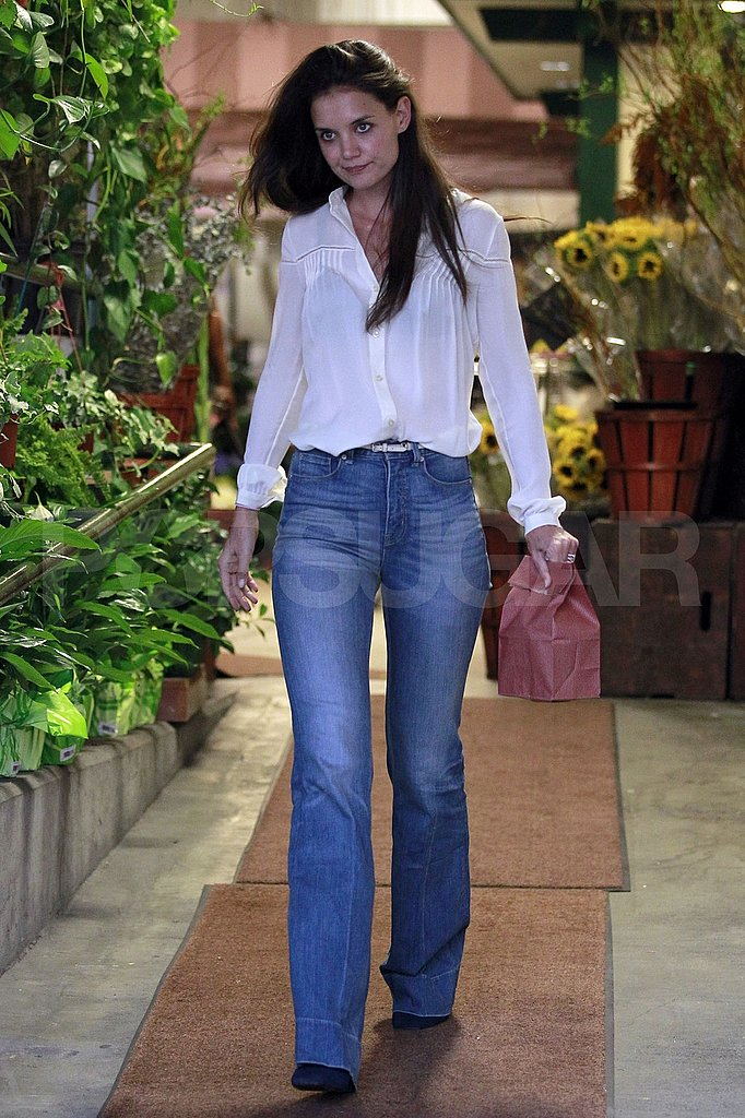 Katie Holmes picking up treats.