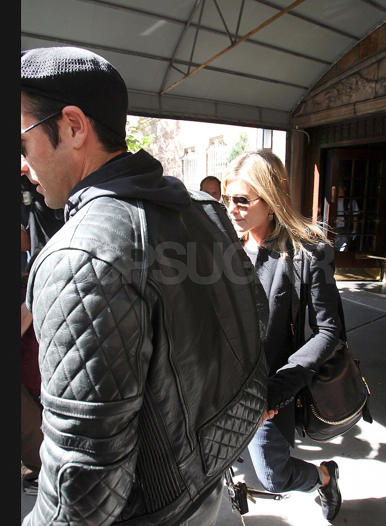 Jennifer Aniston and Justin Theroux leave lunch.