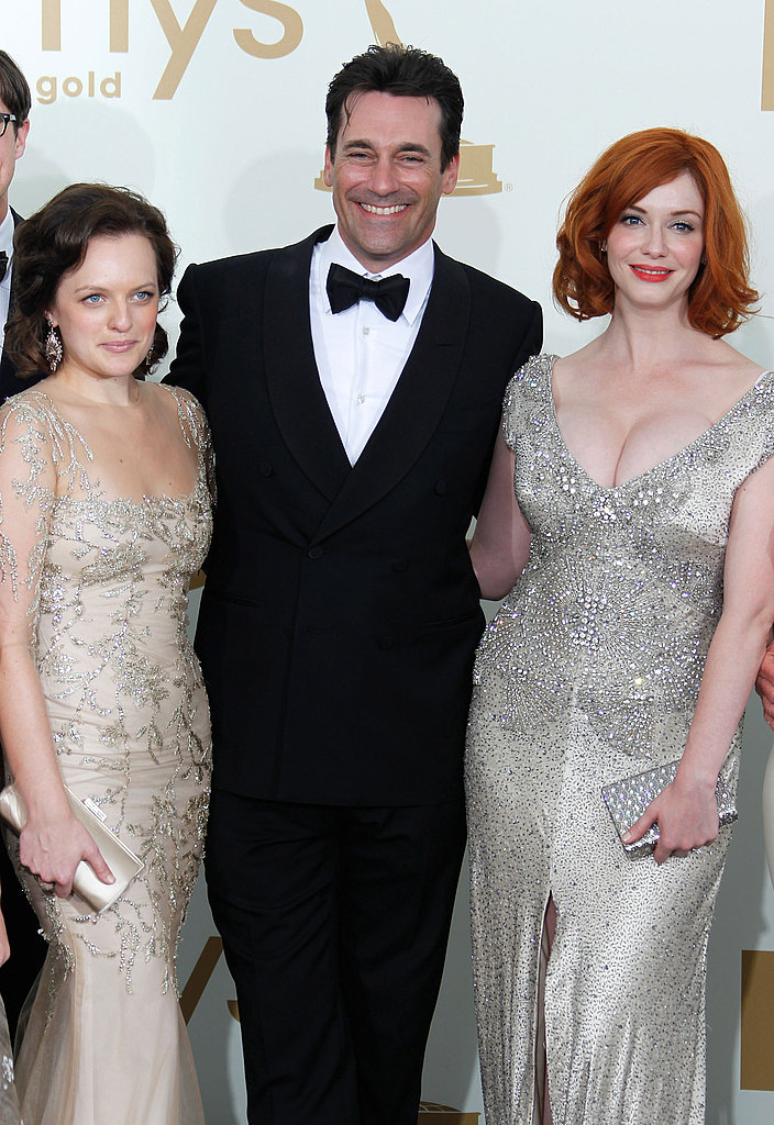 Christina Hendricks, Jon Hamm, and Elisabeth Moss in the Emmys press room.