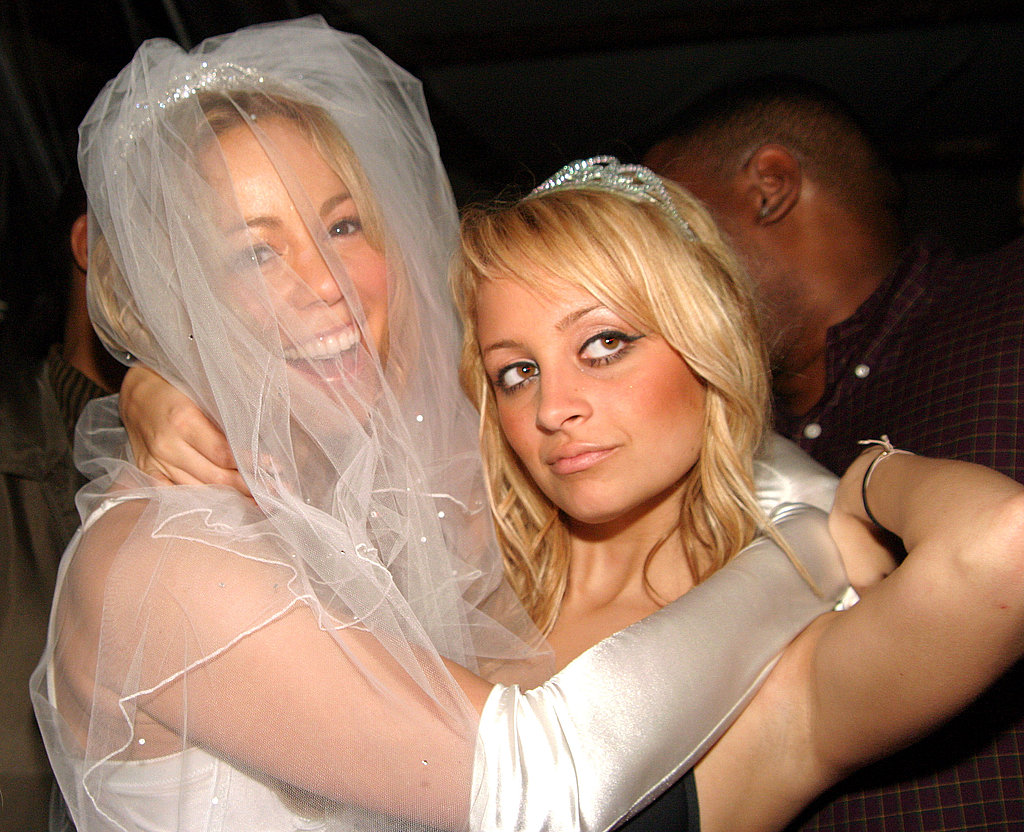 Mariah Carey joked around with Nicole Richie at a 2004 Halloween party in NYC.