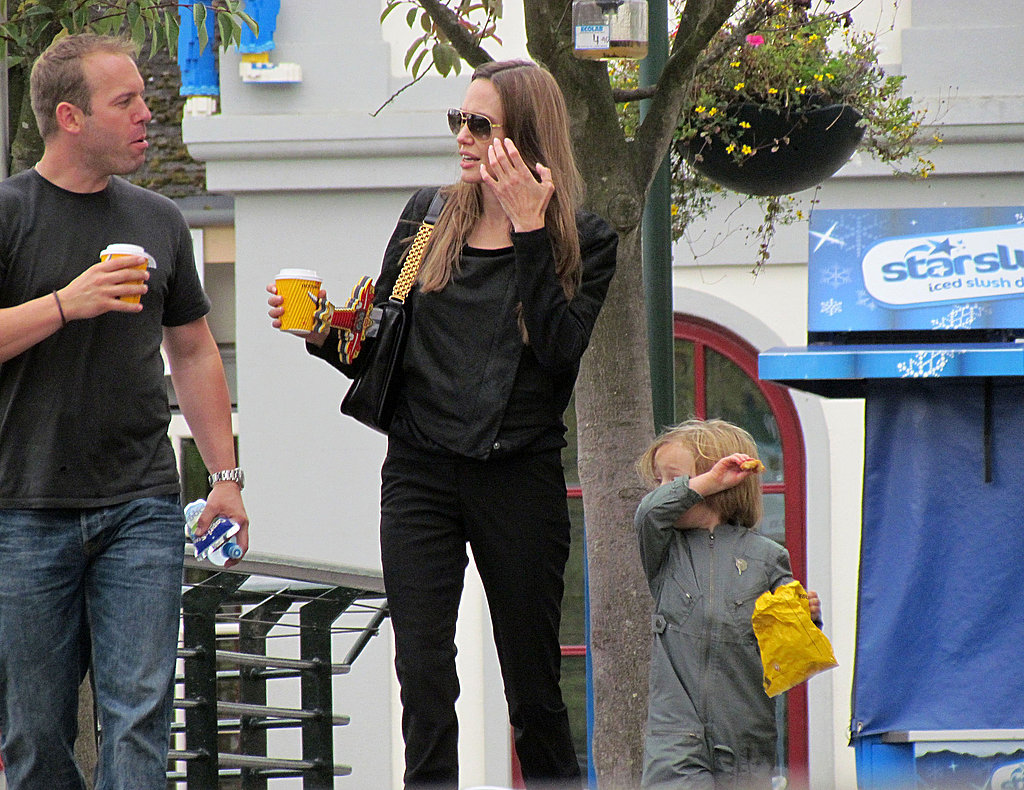 Knox Jolie-Pitt snacks while Angelina Jolie has coffee.
