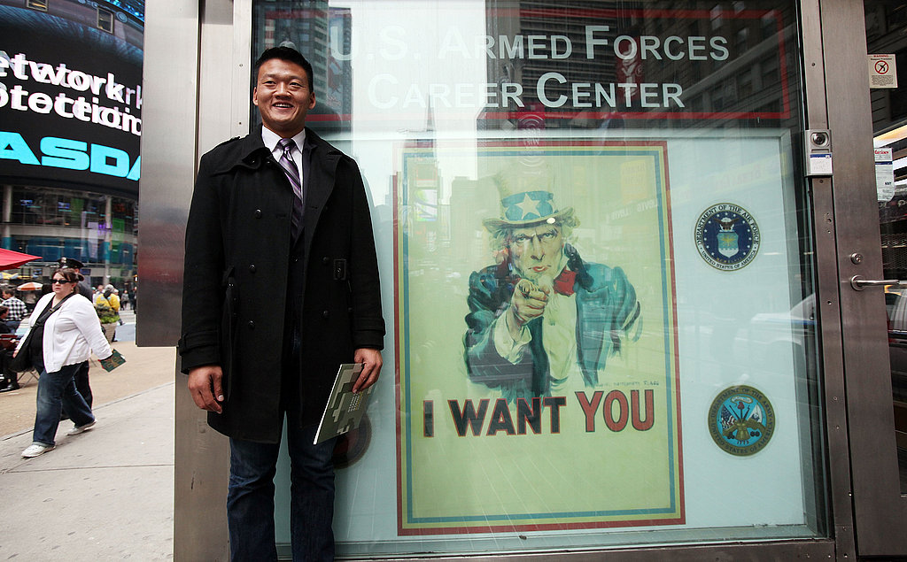 Gay activist and Iraq vet Dan Choi stands outside the Times Square Armed Forces Recruiting Center after he symbolically reenlisted in the US Army on October 20, 2010. The West Point grad with a degree in Arabic was discharged after coming out on The Rachel Maddow Show in 2009.