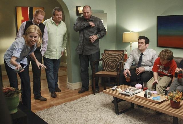 Julie Bowen as Claire, Jesse Tyler Ferguson as Mitchell, Eric Stonestreet as Cam, Ed O'Neill as Jay, Ty Burrell as Phil, and Nolan Gould as Luke on Modern Family.  Photo copyright 2011 ABC, Inc.
