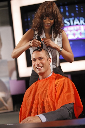 When Tyra decided Nigel's long hair wasn't on brand with his image, she took a razor to it during the judges' panel.  Photo courtesy of The CW